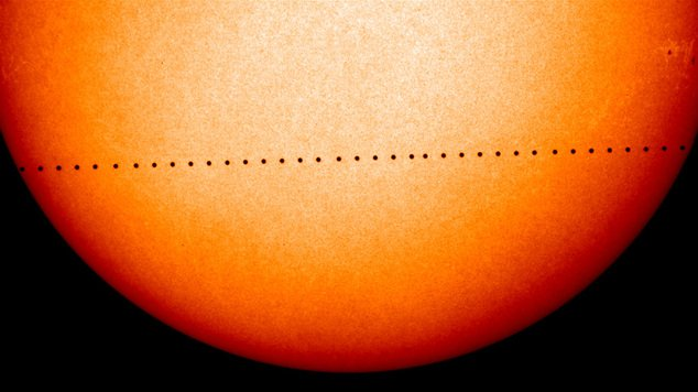 This composite image of observations by NASA and the ESA's Solar and Heliospheric Observatory shows the path of Mercury during its November 2006 transit. On Monday, May 9, 2016, the solar system's smallest, innermost planet will resemble a black dot as it passes in front of the Sun. NASA says the event occurs only about 13 times a century. (Solar and Heliospheric Observatory/NASA/ESA via AP)