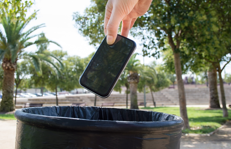Man throwing a phone in the trash ** Note: Visible grain at 100%, best at smaller sizes