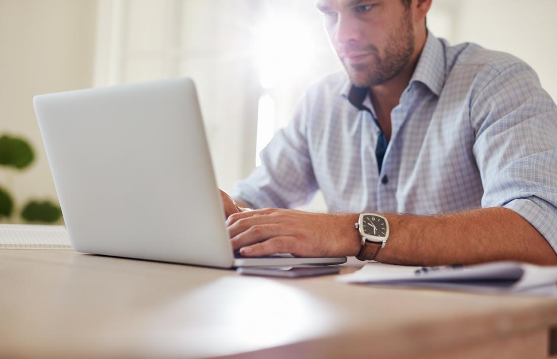 man typing at a computer